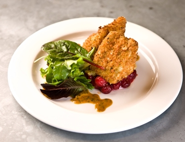 Deep fried brie sage and nut crust with cranberry compote
