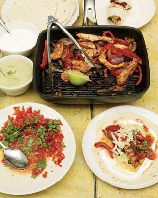 Chicken fajitas with homemade guacamole and salsa