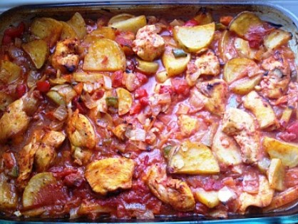 Oven baked chicken casserole with vegetables cooked in tomato sauce