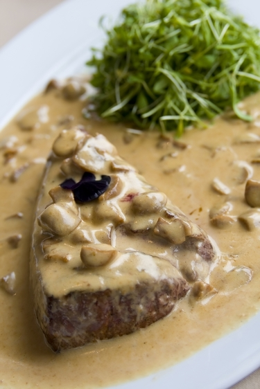 Prime steak with a creamy mushroom sauce