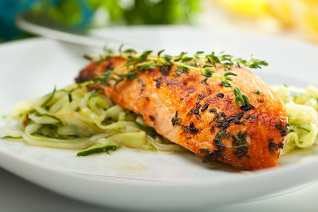 Salmon with linguini and tomato sauce with herbs