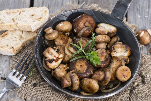 Baked mushrooms with ricotta cheese and pesto