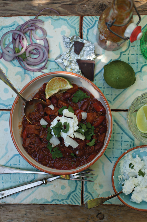 Chocolate chilli con carne with coconut yoghurt and jazzy onions