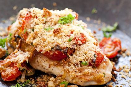 Baked chicken and goats cheese with cherry tomatoes