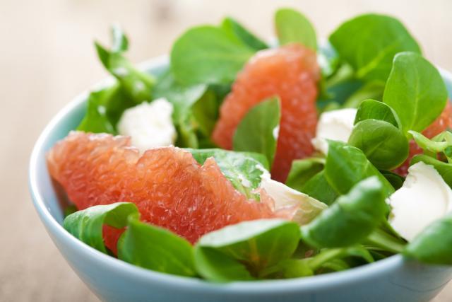 Pink grapefruit and mixed greens salad