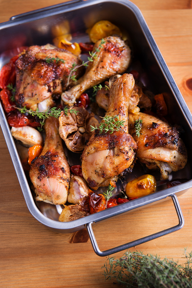 Chicken with baked tomatoes