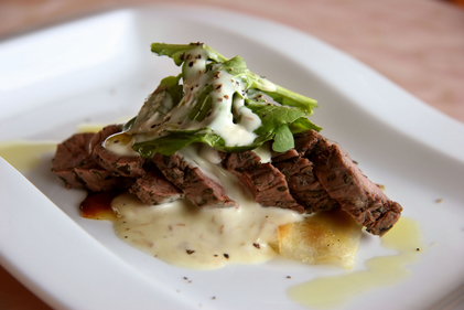 Rib-eye steak with herb hollandaise