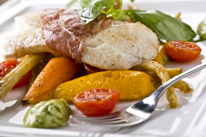 Roasted cod with parma ham and peppers
