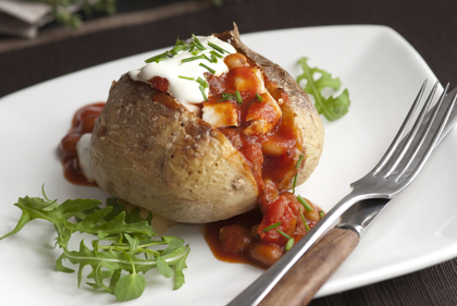 Baked potato with spicy chicken