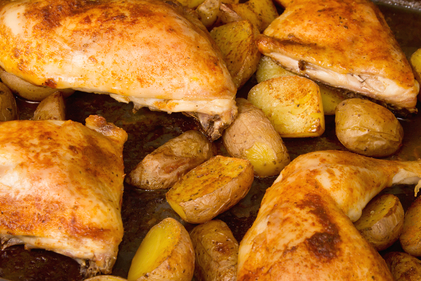 Mild spiced chicken with potato wedges