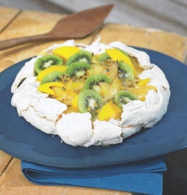 Coconut toasted meringue with lemon curd cream and tropical fruit