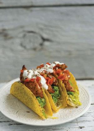 Blackened chicken tacos with avocado and pea guacamole