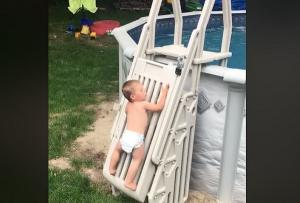 Parents share warning after toddler caught scaling child-proof gate