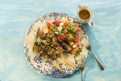 Lamb skewers with rocket melon strawberry salad