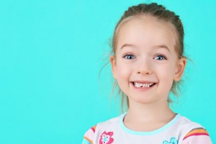 Why losing their first baby tooth makes children so happy