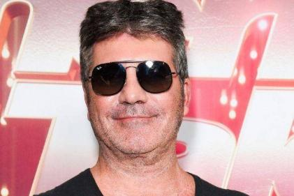 Simon Cowell just posted a snap of son Eric and he looks SO grown-up