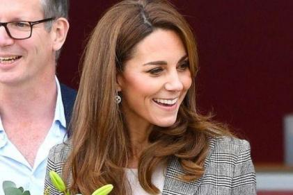The Duchess of Cambridge stuns in plaid dress at royal Christmas lunch