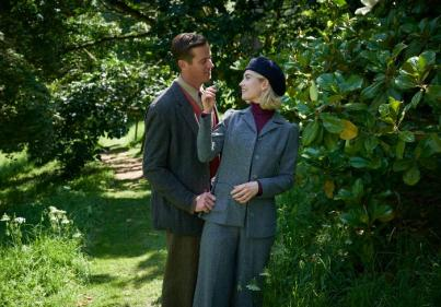 Heres your first look at Lily James and Armie Hammers Rebecca