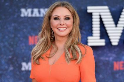 Twinning: Carol Vorderman poses with her lookalike daughter in rare pic