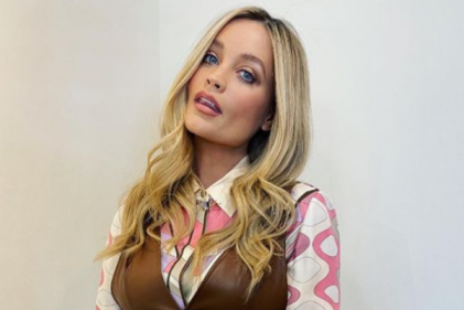 Laura Whitmore shows off her growing bump while filming for Celebrity Juice