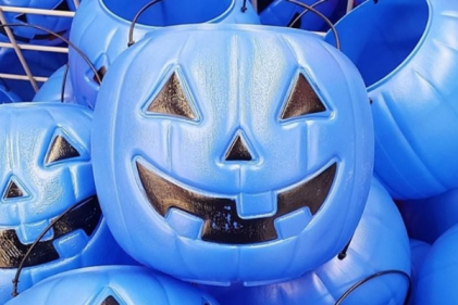 What does it mean when a child carries a blue bucket on Halloween night?