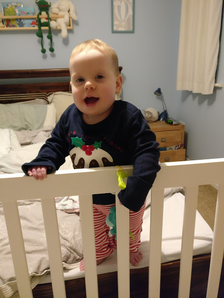 Baby in christmas pudding stripey pyjamas